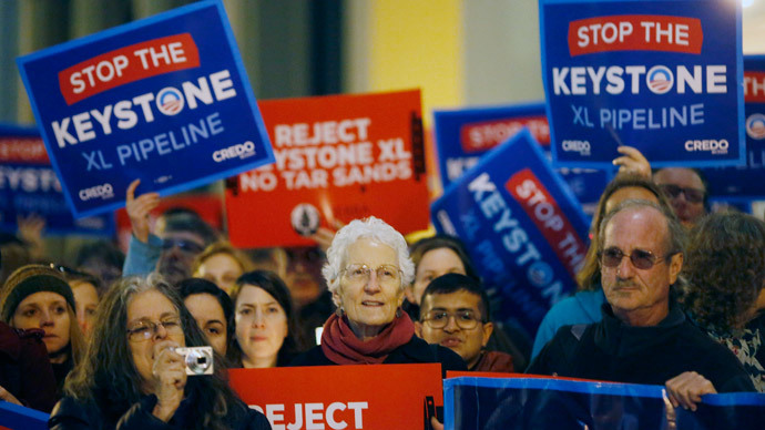 Demonstrators protest against the proposed Keystone XL oil pipeline in San Francisco, California February 3, 2014.(Reuters / Stephen Lam)
