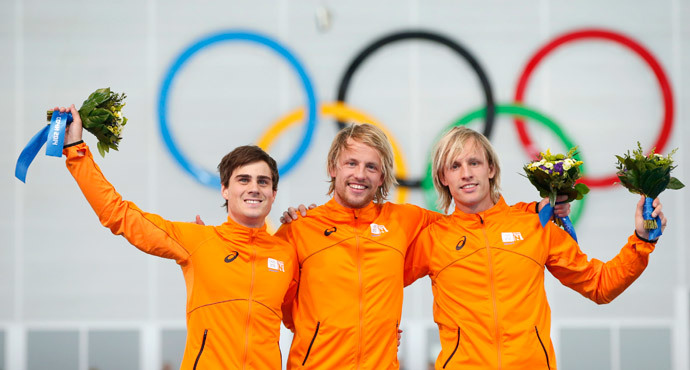 Winner of the men's 500 meters speed skating competition Michel Mulder of the Netherlands (C), second placed Jan Smeekens of the Netherlands (L) and third placed Ronald Mulder of the Netherlands celebrate at the flower ceremony for the event at the 2014 Sochi Winter Olympics, February 10, 2014. (Reuters / Marko Djurica)