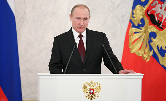 December 12, 2013. President Vladimir Putin reads his annual address to the Federal Assembly in the St. George's Hall of the Kremlin. (RIA Novosti / Mihail Metzel)