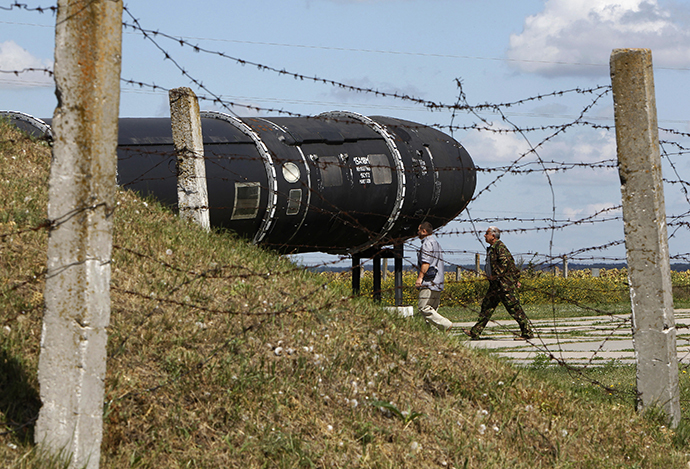 Visitors walk past an SS-18 SATAN intercontinental ballistic missile at the Strategic Missile Forces museum near Pervomaysk, some 300 km (186 miles) south of Kiev (Reuters / Gleb Garanich)