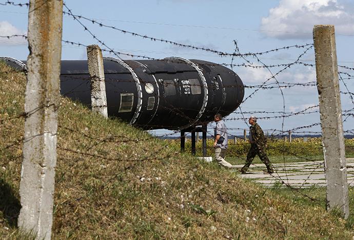 Visitors walk past an SS-18 SATAN intercontinental ballistic missile at the Strategic Missile Forces museum near Pervomaysk, some 300 km (186 miles) south of Kiev (Reuters / Gleb Garanich)