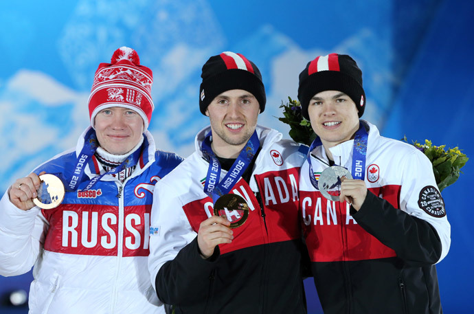 (From L) Russia's bronze medalist Alexandr Smyshlyaev, Canada's gold medalist Alex Bilodeau and Canada's silver medalist Mikael Kingsbury pose on the podium during the Men's Freestyle Skiing Moguls Medal Ceremony at the Sochi medals plaza during the Sochi Winter Olympics on February 11, 2014 (AFP Photo / Loic Venance)