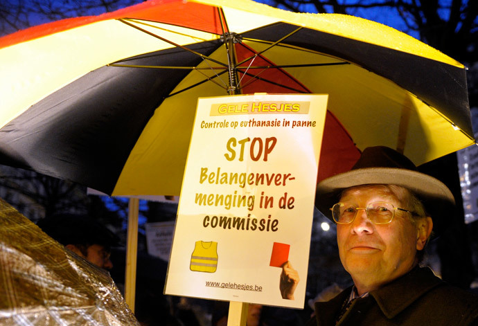 A protester holds up a sign during a demonstration against a new law authorizing euthanasia for children, in Brussels February 11, 2014. (Reuters / Laurent Dubrule)