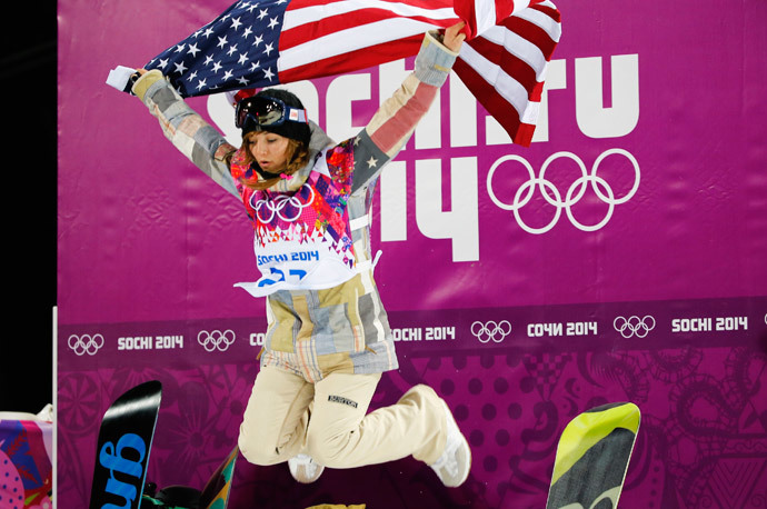 Winner Kaitlyn Farrington of the U.S. celebrates with the U.S. flag after the women's snowboard halfpipe finals at the 2014 Sochi Winter Olympic Games in Rosa Khutor February 12, 2014 (Reuters / Mike Blake)