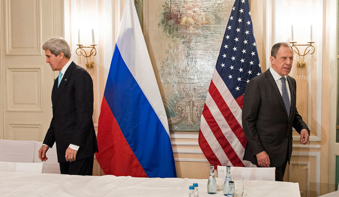 U.S. Secretary of State John Kerry (L) and Russian Foreign Minister Sergei Lavrov take their seats prior to a meeting in Munich January 31, 2014.(Reuters / Brendan Smialowski)