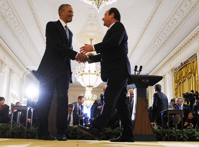 US President Barack Obama shakes hands with French President Francois Hollande during a joint press conference following their meetings in the East Room at the White House in Washington, DC, on February 11, 2014.(AFP Photo /Jewel Samad )