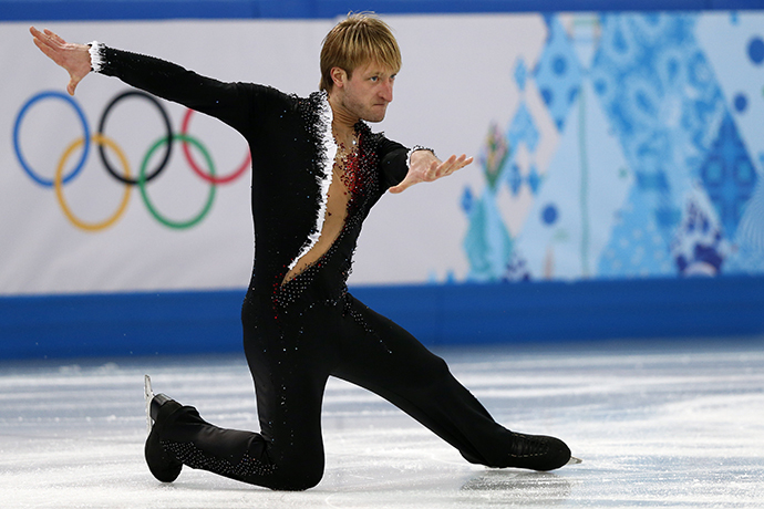 Russia's Yevgeny Plushenko performs in the Men's Figure Skating Team Short Program at the Iceberg Skating Palace during the Sochi Winter Olympics on February 6, 2014. (AFP Photo / Adrian Dennis)