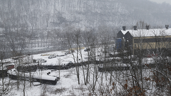 The wreckage of a train derailment lies in the snow near Vandergrift, Pennsylvania February 13, 2014. (Reuters / Jason Cohn)