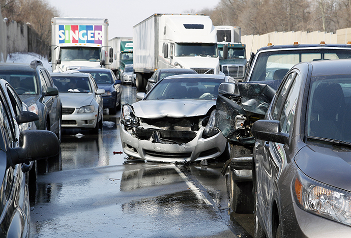 Smashed vehicles await assistance as dozens of flipped-over cars, jack-knifed tractor-trailers and vehicles skidded off the Pennsylvania Turnpike during the morning commute, shutting down the major thoroughfare near the Bensalem interchange in Pennsylvania, February 14, 2014. (Reuters / Tom Mihalek)