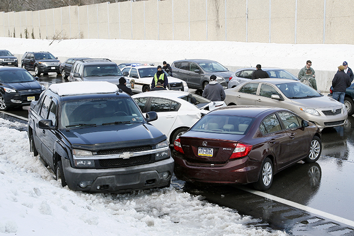 Drivers stand outside of their cars as traffic is backed up following a multi-car and truck accident during the morning commute, shutting down the major thoroughfare near the Bensalem interchange in Pennsylvania, February 14, 2014. (Reuters / Tom Mihalek)