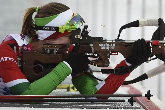Belarus' Darya Domracheva competes at the firing range in the Women's Biathlon 15 km Individual at the Laura Cross-Country Ski and Biathlon Center during the Sochi Winter Olympics on February 14, 2014 in Rosa Khutor near Sochi. (AFP Photo / Odd Andersen)