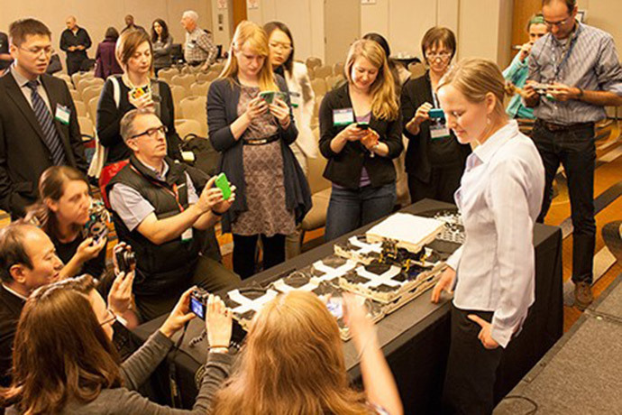 Kirstin Petersen demonstrates termite-inspired robots at an annual meeting news briefing (Image credit: AAAS/Janel Kiley)