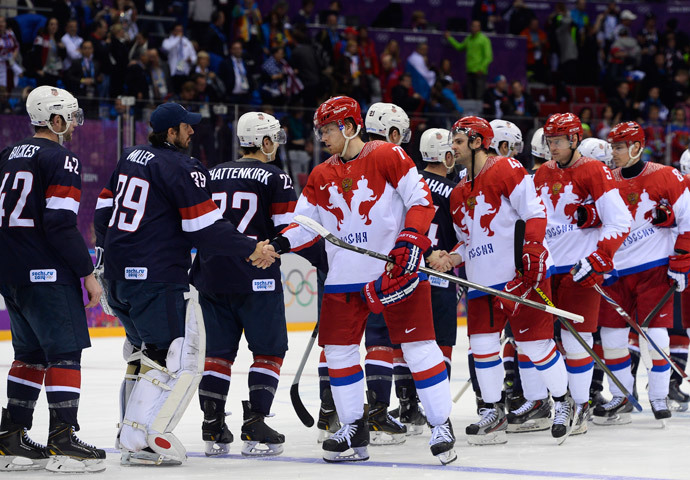 US and Russia's players shake hands after a penelty shootout at the end of the Men's Ice Hockey Group A match USA vs Russia at the Bolshoy Ice Dome during the Sochi Winter Olympics on February 15, 2014 in Sochi. US won 3-2 in the penalty shootout.(AFP Photo / Jonathan Nackstrand)