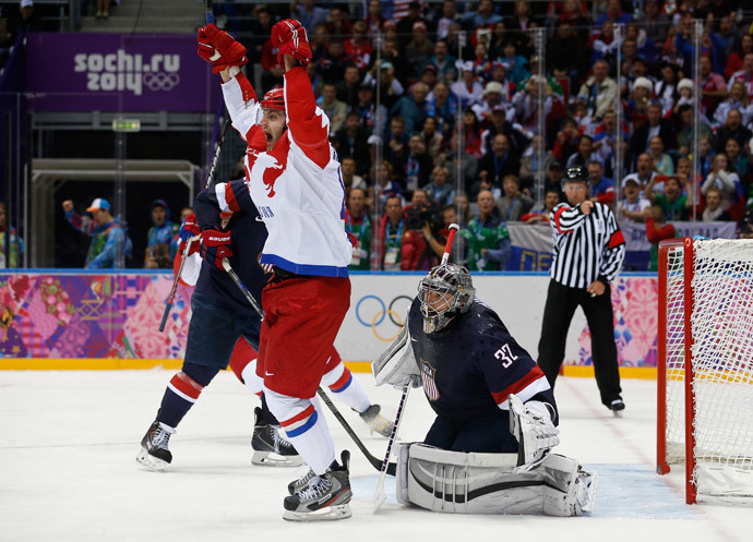Russia's Alexander Radulov (L) celebrates a goal by teammate Pavel Datsyuk (not pictured) against Team USA's goalie Jonathan Quick, during the third period of their men's preliminary round ice hockey game at the Sochi 2014 Winter Olympic Games February 15, 2014 (Reuters / Jim Young)