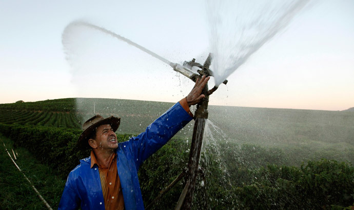 Brazilian coffee producer Marcio Diogo adjusts an irrigation system in his farm in Santo Antonio do Jardim (Reuters / Paulo Whitaker)