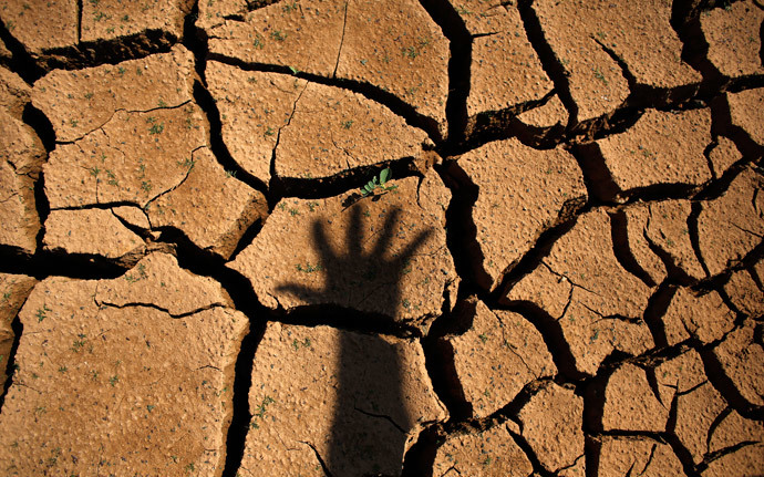 The shadow of a hand is seen on the cracked ground of Jaguary dam during a long drought period that hit the state of Sao Paulo in Braganca Paulista, 100 km from Sao Paulo (Reuters / Nacho Doce)