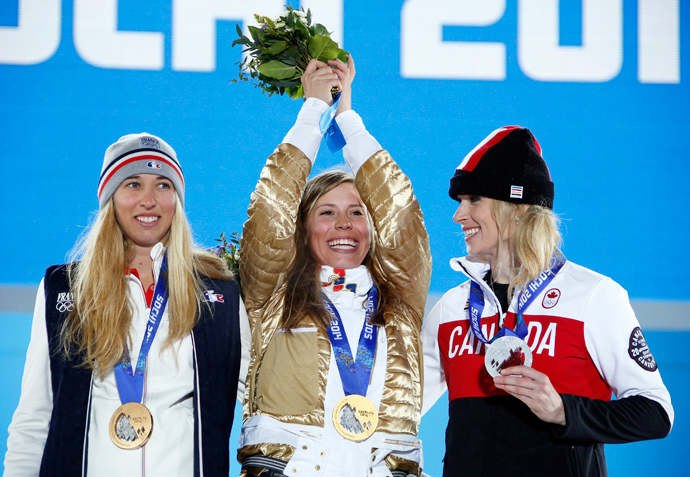 Gold medallist Eva Samkova of the Czech Republic poses with silver medallist Canada's Dominique Maltais (R) and bronze medallist France's Chloe Trespeuch (L) during the victory ceremony for the women's snowboard cross competition at the 2014 Sochi Winter Olympics February 16, 2014 (Reuters / Eric Gaillard)