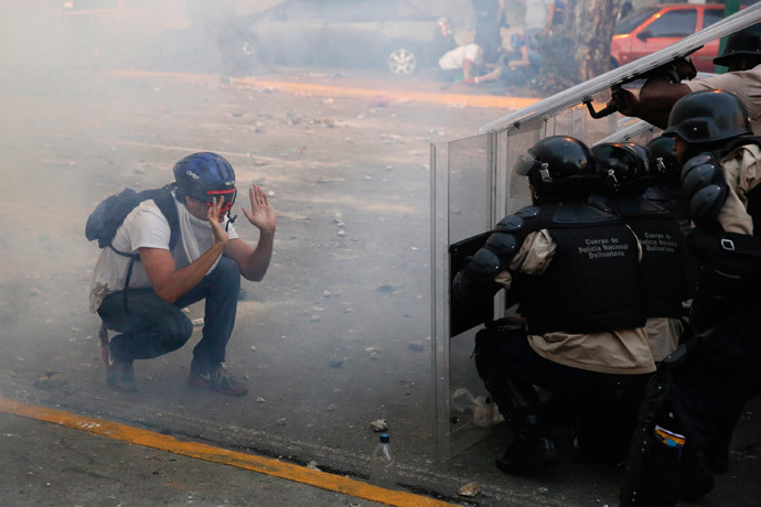 An opposition demonstrator confronts riot police during a protest against President Nicolas Maduro's government in Caracas February 15, 2014. (Reuters / Carlos Garcia Rawlins)