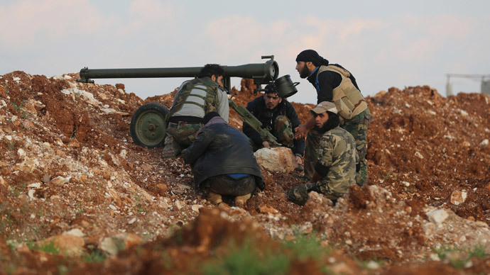 Rebel fighters prepare to fire an anti-tank cannon towards the government forces Al-Samman checkpoint on a road leading to Idlib near the Syrian city of Hama, on February 17, 2014. (AFP Photo / Abu Hadi Al-Hamwi)