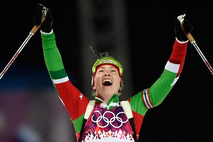 Belarus' Darya Domracheva celebrates as she wins gold in the Women's Biathlon 12,5 km Mass Start at the Laura Cross-Country Ski and Biathlon Center during the Sochi Winter Olympics on February 17, 2014, in Rosa Kuthor, near Sochi. (AFP Photo / Odd Andersen)