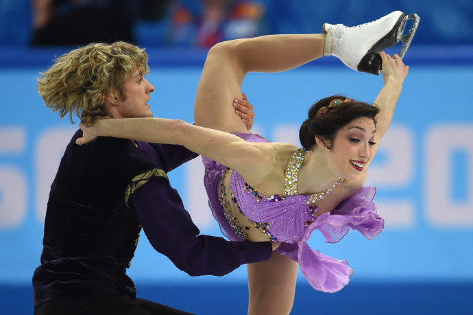 US Charlie White and US Meryl Davis compete in the Figure Skating Ice Dance Free Dance at the Iceberg Skating Palace during the Sochi Winter Olympics on February 17, 2014. (AFP Photo / Damien Meyer)