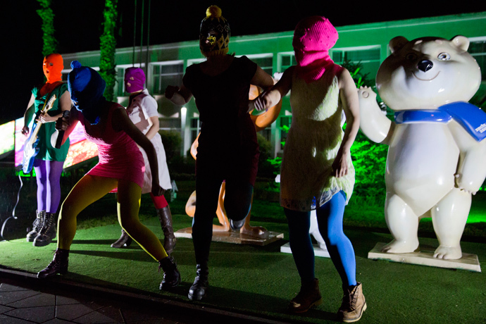 Members of Russian punk group Pussy Riot, Nadezhda Tolokonnikova (front L) and Maria Alyokhina (front R) perform in front of Sochi 2014 Winter Olympic games mascots as they record a video in the Adler district of Sochi, early on February 18, 2014 (AFP Photo / Evgeny Feldman)