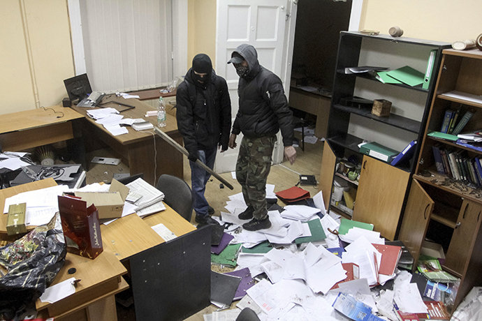 Anti-government rioters are seen inside the destroyed prosecutor's office in Lviv February 19, 2014. (Reuters / Marian Striltsiv)