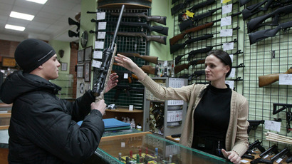 Salesperson consulting a customer in an arms shop in Omsk. (RIA Novosti/Alexey Malgavko)
