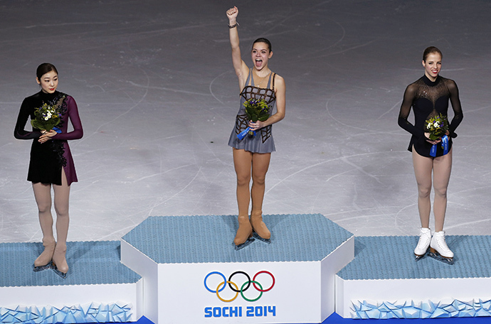 Russia's Adelina Sotnikova stands in first place, Korea's Yuna Kim stands in second place and Italy's Carolina Kostner stands in third place on the podium during the Figure Skating Women's free skating Program at the Sochi 2014 Winter Olympics, February 20, 2014. (Reuters / Issei Kato)