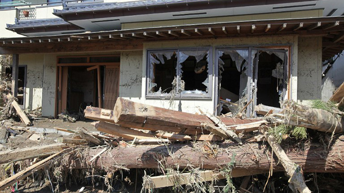 A damaged house, caused by a tsunami, is seen in Minamisoma city, Fukushima prefecture on March 12, 2011. (AFP Photo / Jiji Press)