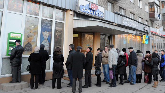 Panic-stricken Ukrainians queuing at shops, banks and gas stations