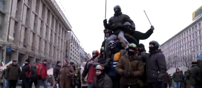 RT video still: Masked protesters in the center of Kiev.