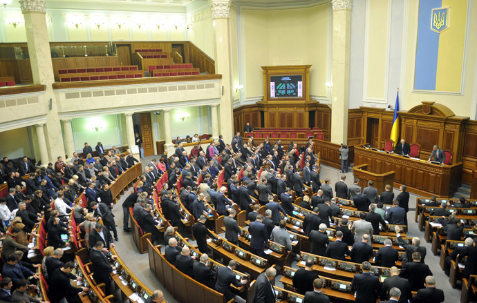 Deputies of the Ukrainian parliament vote for a constitution change in Kiev on February 21, 2014.(AFP Photo / Genya Savilov )