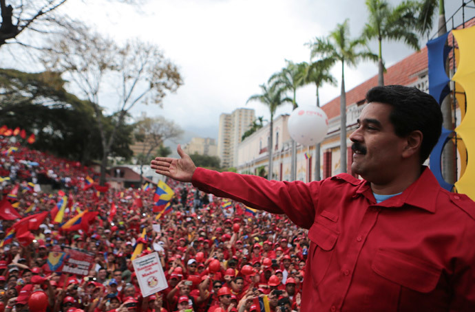Venezuela's President Nicolas Maduro greets supporters during a rally in Caracas February 18, 2014.(Reuters / Miraflores Palace)