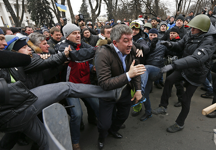 Anti-government protesters attack a deputy of the Party of Regions Vitaly Grushevsky (C) outside the Ukrainian Parliament building in Kiev February 22, 2014. (Reuters / Vasily Fedosenko)