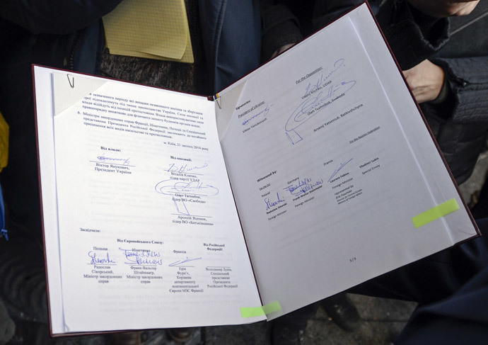 The signed peace deal document between Ukraine's President Viktor Yanukovich and opposition leaders is seen in Kiev, February 21, 2014. (Reuters / Andrew Kravchenko)
