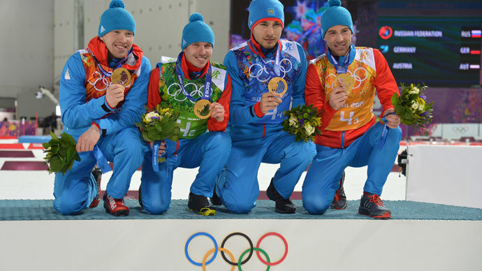 From left: gold medalists Russia's Anton Shipulin, Dmitry Malyshko, Evgeny Ustyugov and Alexey Volkov (AFP Photo / Alberto PIizzoli)