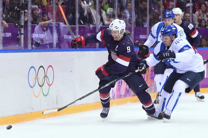 US Zach Parise (L) vies with Finland's Kimmo Timonen during the Men's ice hockey Bronze Medal Game USA vs Finland at the Bolshoy Ice Dome (AFP Photo / Andrej Isakovic)