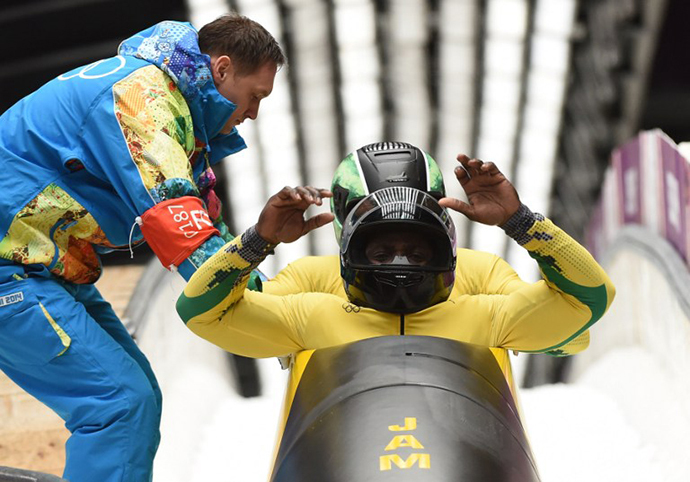 Jamaica-1 two-man bobsleigh pilot Winston Watts and brakeman Marvin Dixon compete in the Bobsleigh Two-man Heat 3 at the Sliding Center Sanki during the Sochi Winter Olympics on February 17, 2014. (AFP Photo / Leon Neal)