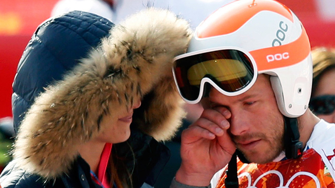 Third-placed Bode Miller (R) of the U.S. cries after the men's alpine skiing Super-G competition during the 2014 Sochi Winter Olympics at the Rosa Khutor Alpine Cente February 16, 2014. (Reuters / Mike Segar)