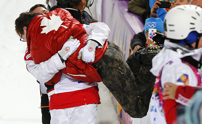 Winner Canada's Alex Bilodeau (L) embraces his brother Frederic after the men's freestyle skiing moguls competition at the 2014 Sochi Winter Olympic Games in Rosa Khutor February 10, 2014. (Reuters / Mike Blake)