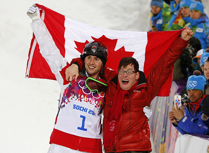 Winner Canada's Alex Bilodeau and his brother Frederic celebrate following the freestyle skiing moguls competition at the 2014 Sochi Winter Olympic Games in Rosa Khutor February 10, 2014. (Reuters / Mike Blake)