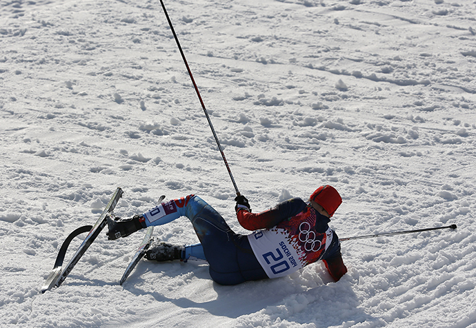 Russia's Anton Gafarov lies on the ground after crashing in the men's cross-country sprint semi-final at the Sochi 2014 Winter Olympic Games in Rosa Khutor February 11, 2014. (Reuters / Stefan Wermuth)