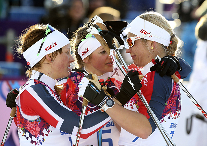 Winner Maiken Caspersen Falla (L) of Norway and her team mate, second placed Ingvild Flugstad Oestberg (C) comfort Astrid Uhrenholdt Jacobsen after competing in the women's cross-country sprint free final at the Sochi 2014 Winter Olympic Games in Rosa Khutor February 11, 2014. (Reuters / Sergei Karpukhin)
