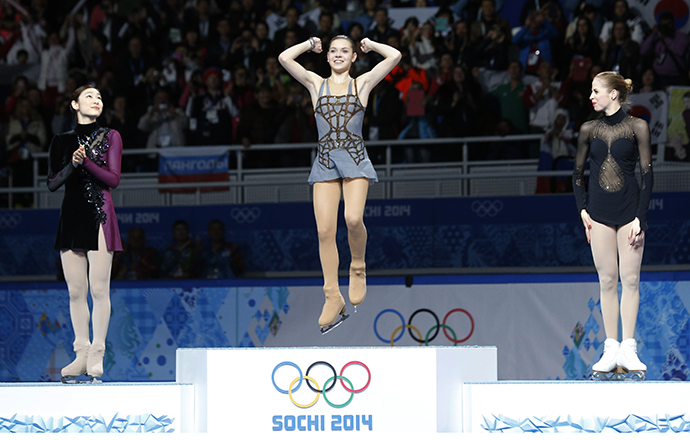 Russia's Adelina Sotnikova celebrates in first place, Korea's Yuna Kim stands in second place and Italy's Carolina Kostner stands in third place on the podium during the Figure Skating Women's free skating Program at the Sochi 2014 Winter Olympics, February 20, 2014. (Reuters / Alexander Demianchuk)