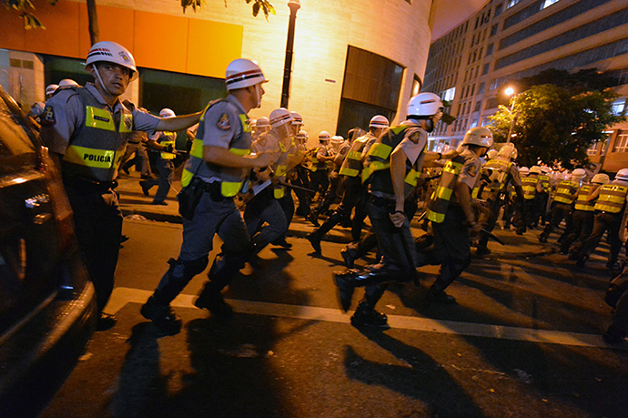 Policemen are deployed during a protest against the government's expenditure for the 2014 FIFA World Cup in Sao Paulo, Brazil on February 22, 2014. (AFP Photo / Nelson Almeida)