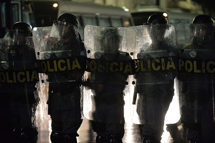 Policemen stand guard during a protest against the government's expenditure for the 2014 FIFA World Cup in Sao Paulo, Brazil on February 22, 2014. (AFP Photo / Nelson Almeida)