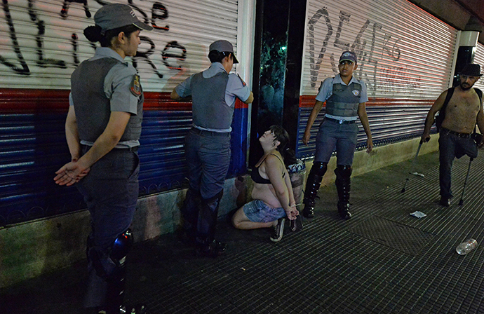 Policewomen arrest a woman during a protest against the government's expenditure for the 2014 FIFA World Cup in Sao Paulo, Brazil on February 22, 2014. (AFP Photo / Nelson Almeida)