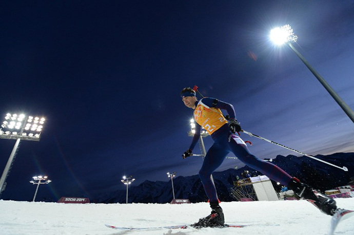 Norway's Ole Einar Bjoerndalen competes in the Biathlon mixed 2x6 km + 2x7,5 km Relay at the Laura Cross-Country Ski and Biathlon Center during the Sochi Winter Olympics on February 19, 2014 in Rosa Khutor near Sochi. (AFP Photo / Kirill Kudryavtsev)