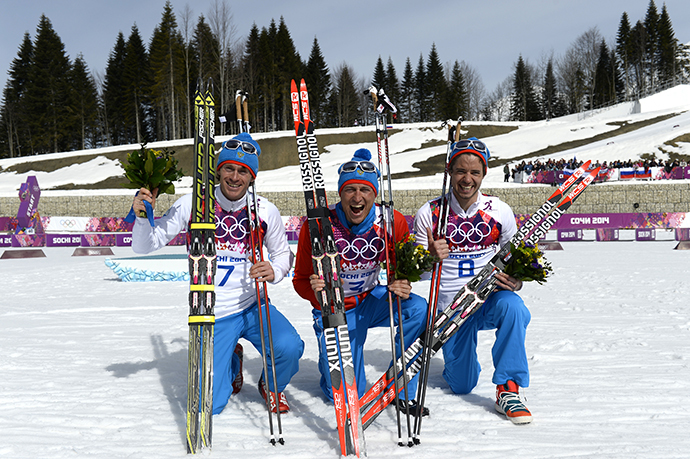 Silver medalist Russia's Maxim Vylegzhanin (7) gold medalist Russia's Alexander Legkov (3) and Bronze medalist Russia's Ilia Chernousov (8) celebrate during the Men's Cross-Country Skiing 50km Mass Start Free Flower Ceremony at the Laura Cross-Country Ski and Biathlon Center during the Sochi Winter Olympics on February 23, 2014, in Rosa Khuto, near Sochi. (AFP Photo / Pierre-Philippe Marcou)